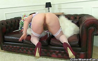 British milf Janey works her deliciously Victorian pussy