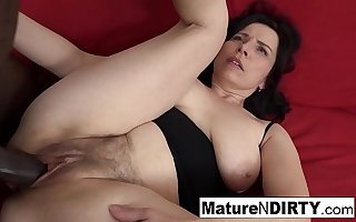 Mature with natural jugs gets a creampie in her hairy pussy!