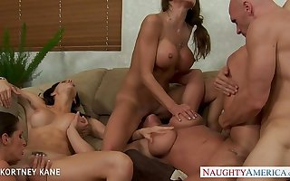 Brunette babe Kortney Kane fucking in groupsex